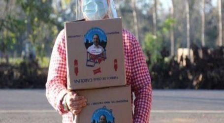 Diputado RN entrega cajas de alimentos y mascarillas con su foto